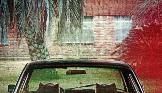 From http://www.arcadefire.com/wp/wp-content/uploads/2010/05/TheSuburbs<em>Artwork</em>cover1.jpg